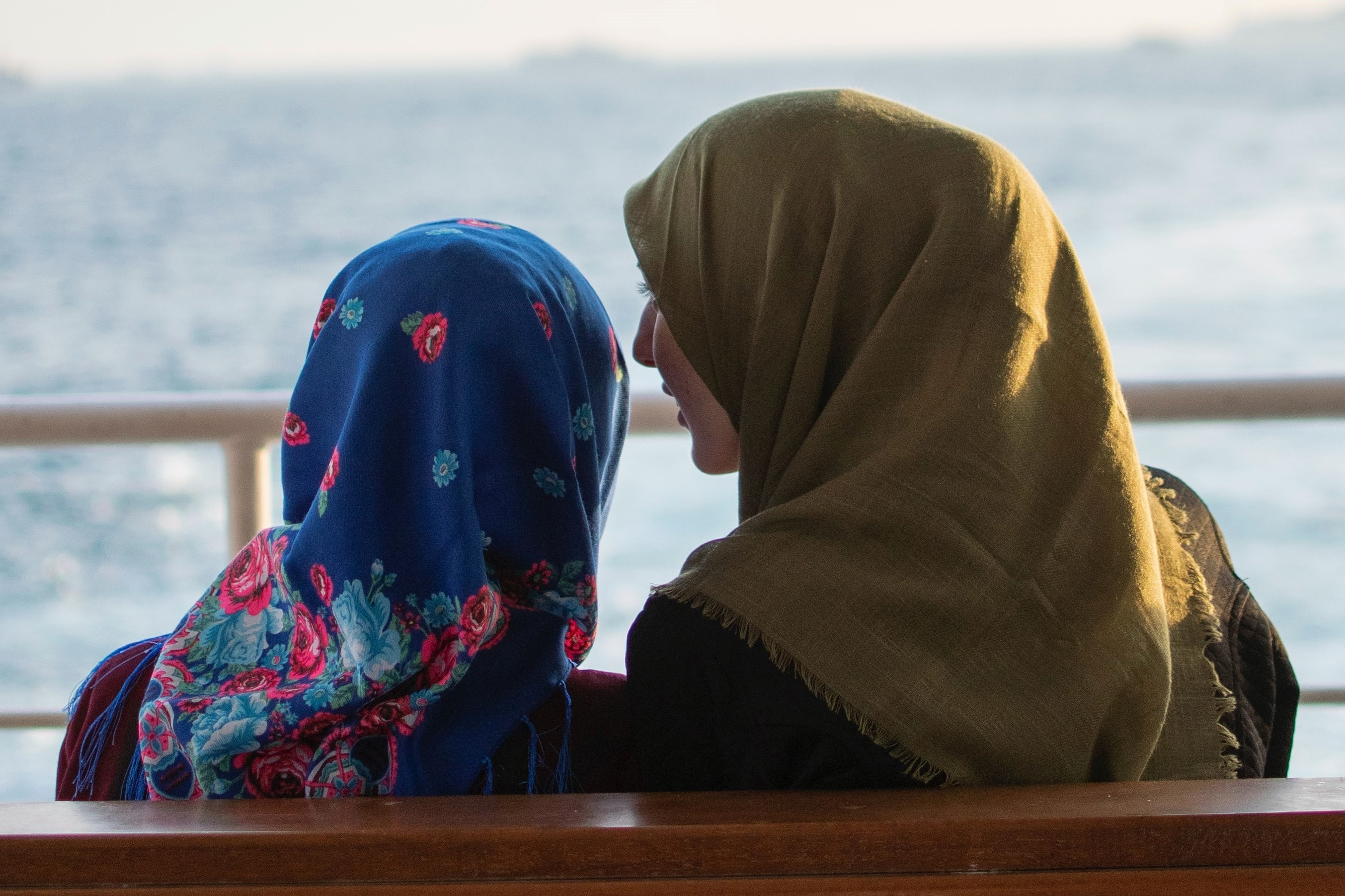 Two women speaking to each other