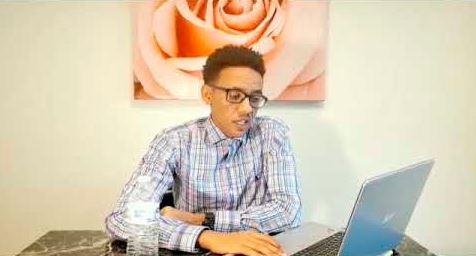 Man at laptop at desk